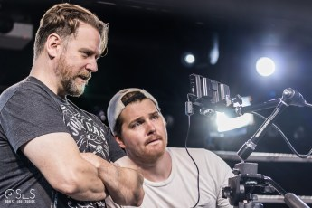 Director Chris Grega (left) and cinematographer Ben Vogelsgang review a shot.