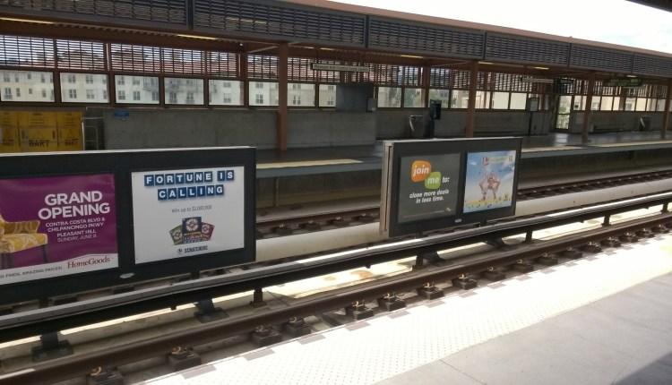 titan BART signs at rail station near tracks