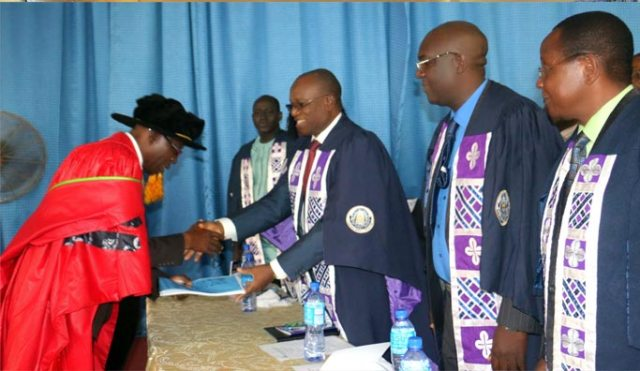 Inaugural Prof.-D.B.-Oke-handing-over-his-Inaugural-Lecture-to-the-Vice-Chancellor,-Prof.-G.O.-Olatunde
