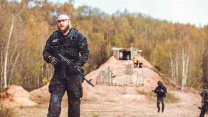 Airsoft player infront of hill