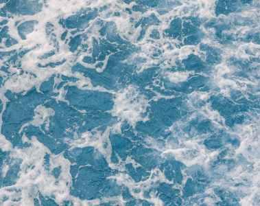 foamy blue sea with powerful waves