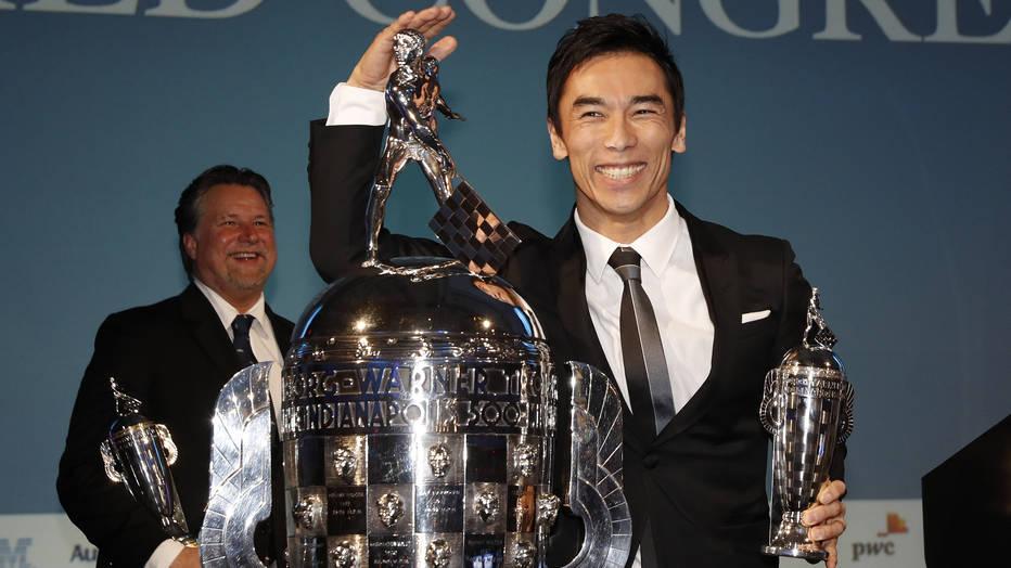 Takuma Sato and Michael Andretti receive their Baby Borg trophies.