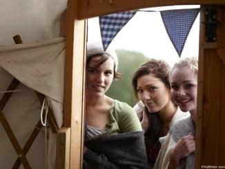 Girls standing in yurt doorway