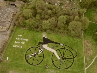 Man riding bike - land art