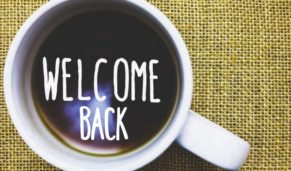 'Welcome Back' written in a cup of coffee