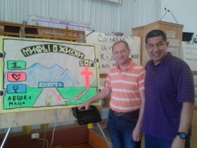 Misha with OACI international evangelist Robert Siakimotu in Omsk