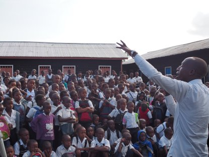 Lively preacher, attentive children: The Congo