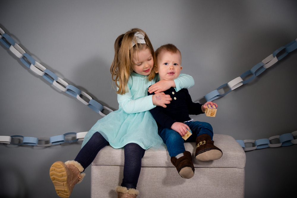Sister hugging brother at Open Box Photography studio