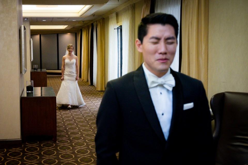 Bride in focus approaching the groom