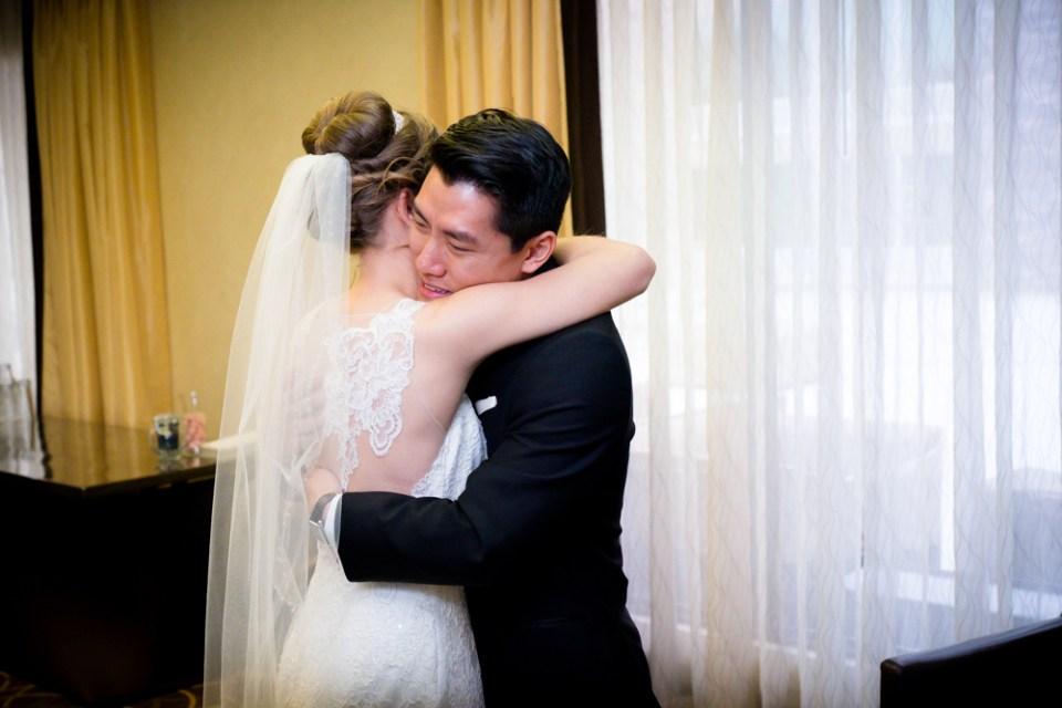 First look hug between bride and groom