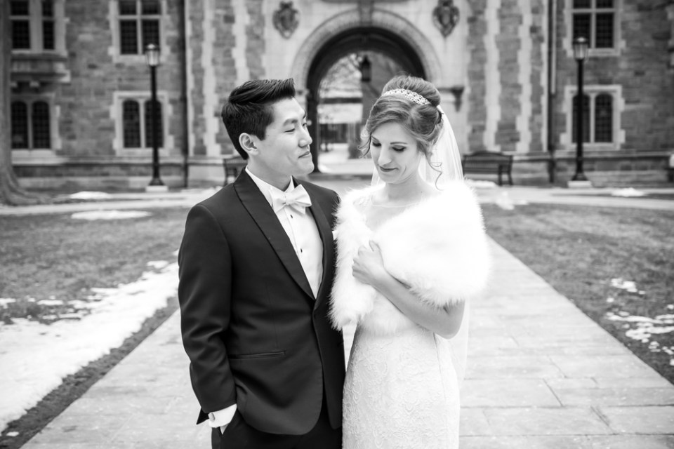 Black and white bride and groom sweet looks in Ann Arbor Law Quad