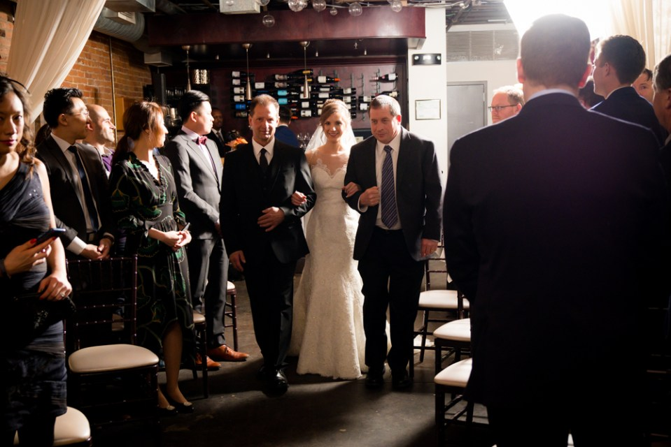 Bride walking down the aisle with Father and Step Father