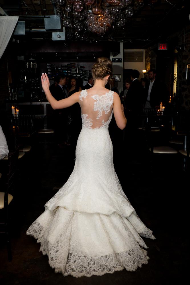 Bride dancing in her beautiful gown