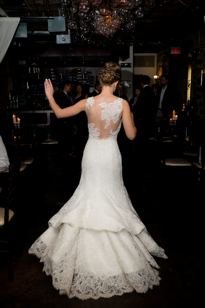 Bride dancing in her beautiful gown