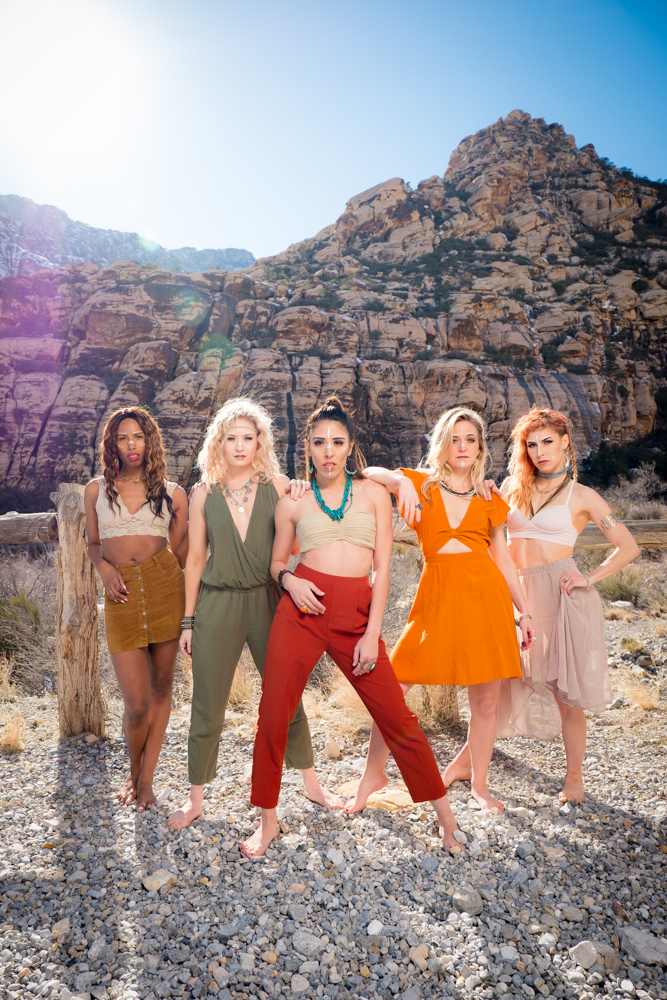 Portrait of the Vegas Bombshells in a power pose in front of a mountain
