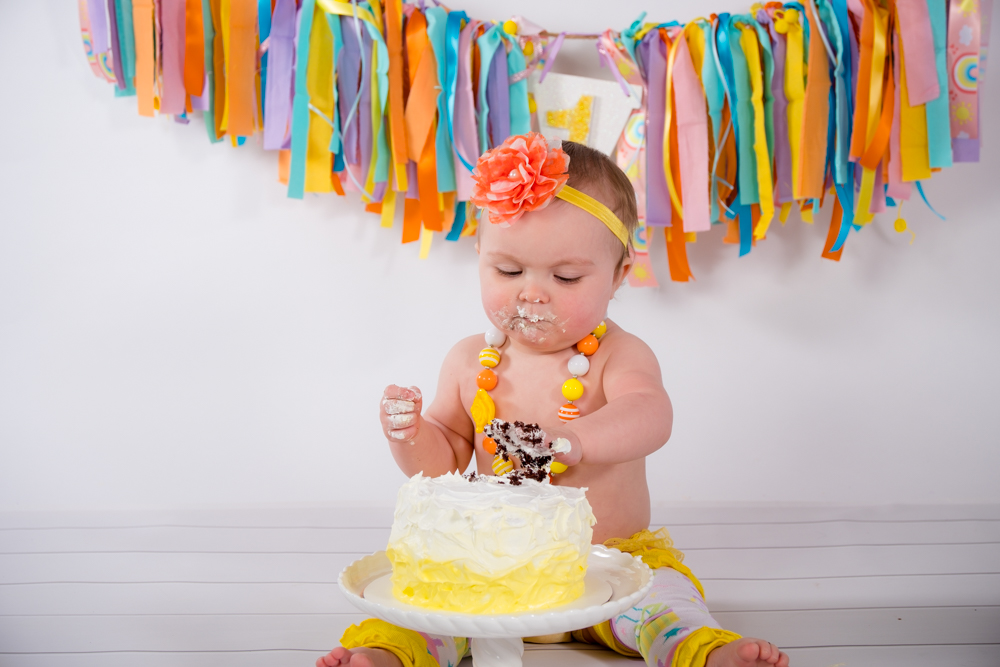 Birthday girl digging into her cake