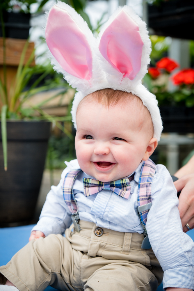 Baby boy smiling with adorable bunny ears