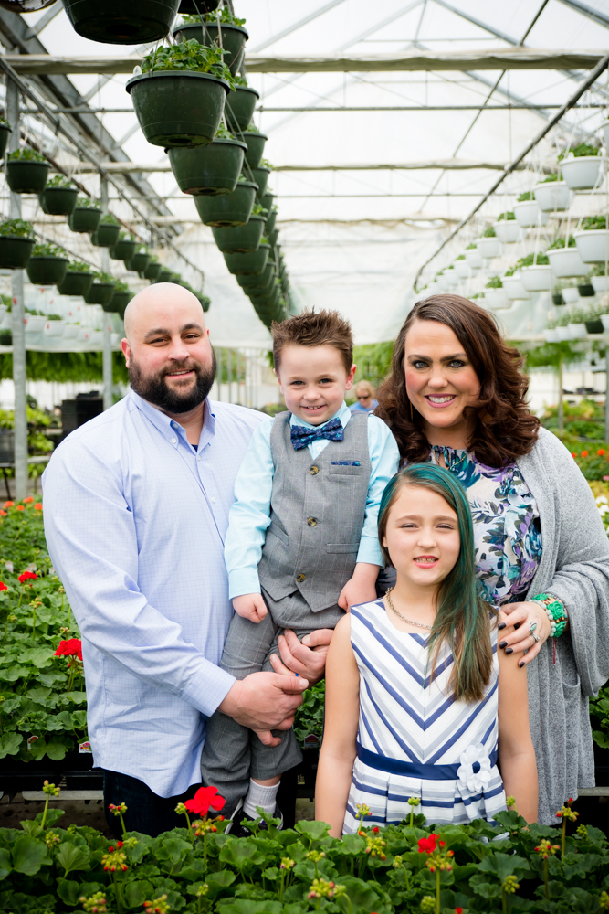 Family of 4 adorablein a greenhouse