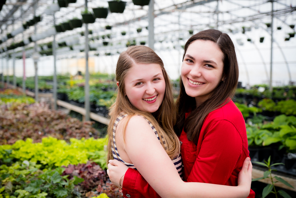 Best friends together at a greenhouse