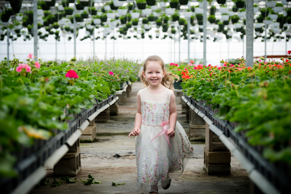 little girl running through flowers