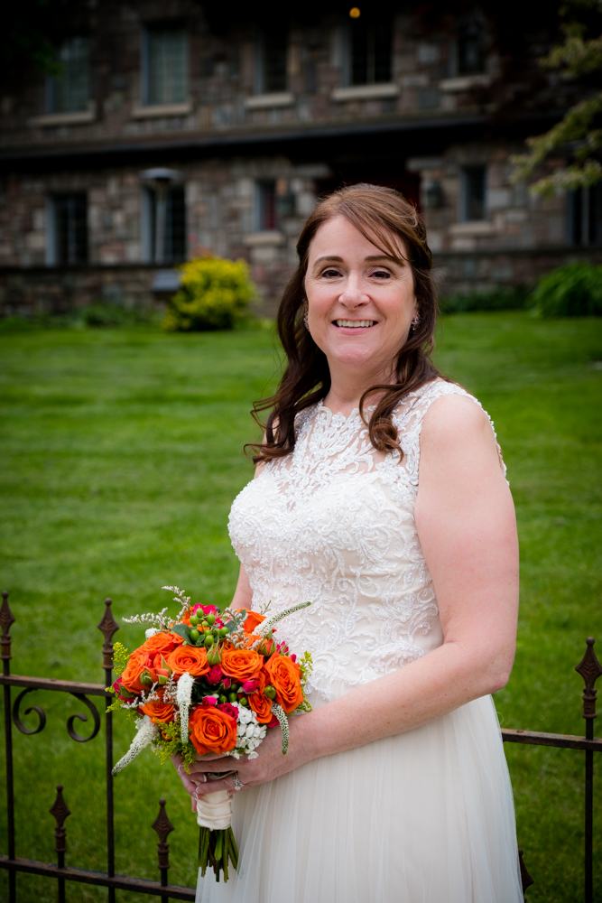 Bride with gorgeous orange bouquet of flowers