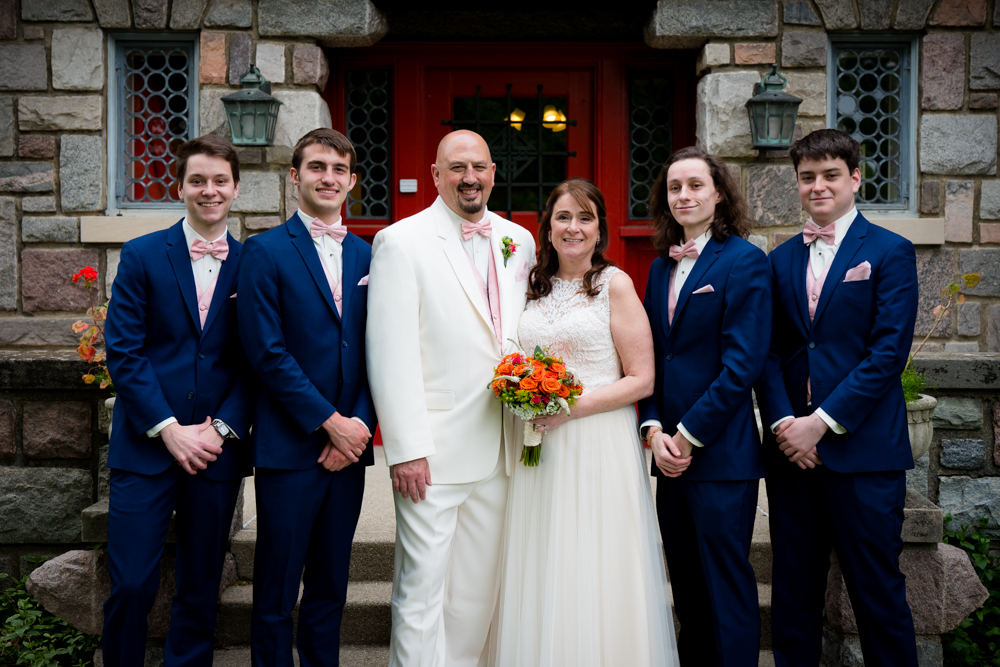 Bride and groom with their four boys.