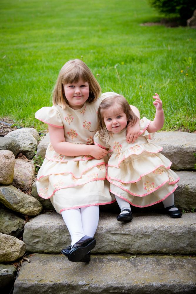 sisters sitting on rock steps