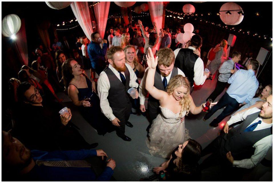 Bride and groom in the center of the dance floor dancing the night away!
