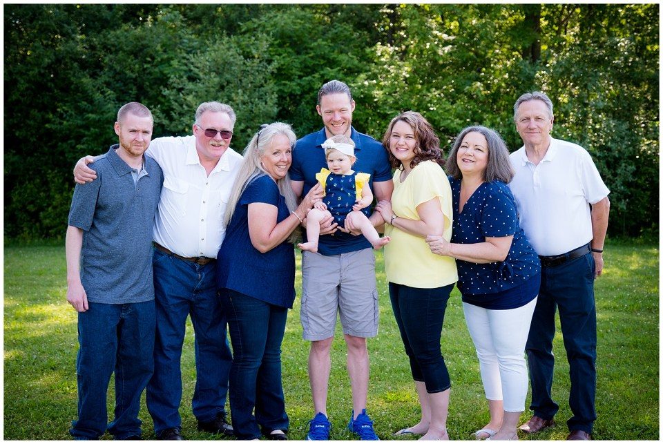Extended family portrait with grandparents and uncle.