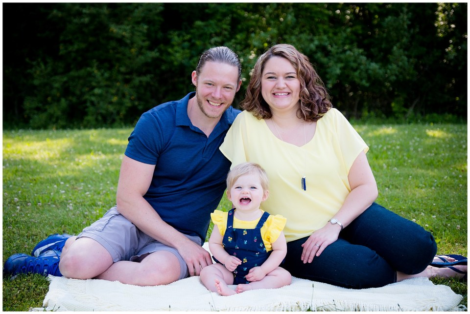 Precious family of three photo sitting outside on a blanket.