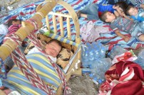 Sleeping child under highway fly-over