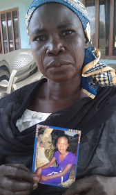 A mother with a picture of her daughter, who was kidnapped by Boko Haram in 2014. Over 200 predominantly Christian schoolgirls were kidnapped by Boko Haram, causing international media attention and the #BringBackOurGirls social media campaign.