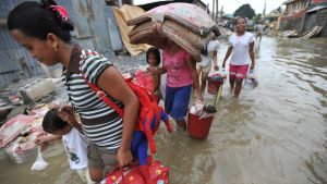 A family affected by Tropical Storm Ketsana (Ondoy) in Manila, Philippines. Image sourced from original post.