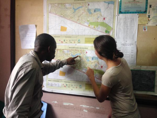 Mr. Alex Jairos Mwisongo in Ndugumbi showing different features of the maps