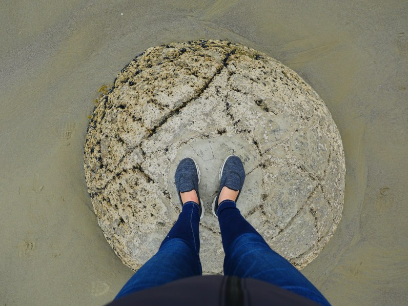 Standing on top of a Moeraki Boulder