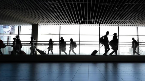 People walking in airport.