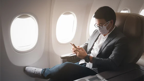 Man sitting in airplane.