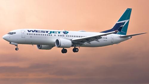 """C-FNAX WestJet Boeing 737 MAX 8"" by Liam Allport is licensed under CC BY 2.0."