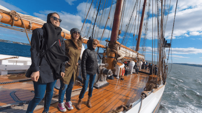 Group on a deck tour of the Bluenose II