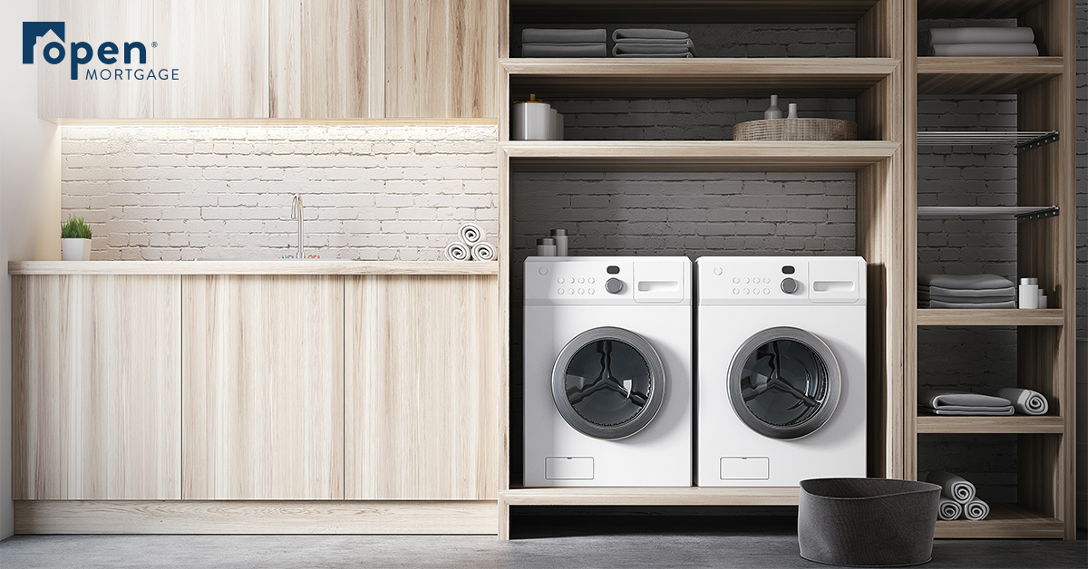 2 washing machines sitting next to wood cabinets