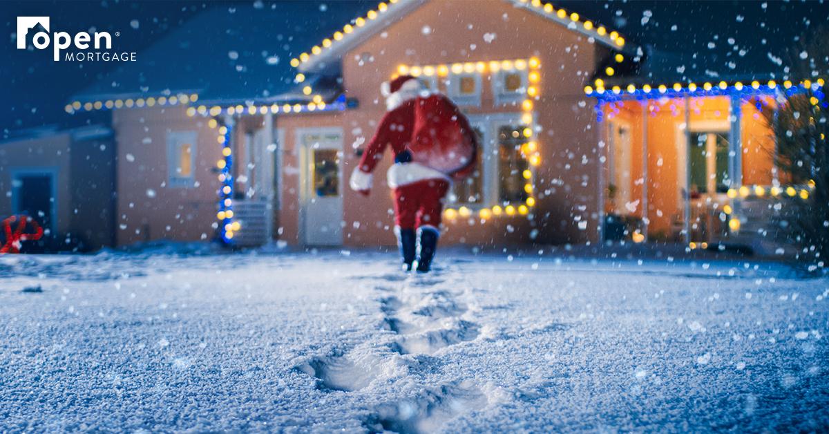 Santa walking to a house