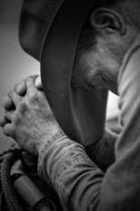 B&W_cowboy praying_vertical