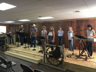 The Outsiders band performing live worship songs at the first service in the new location.