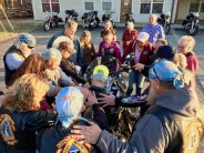 Christian bikers and cowboys alike pause to pray for a member of their chapter of the Christian Motorcyclists Association as they gather at church.
