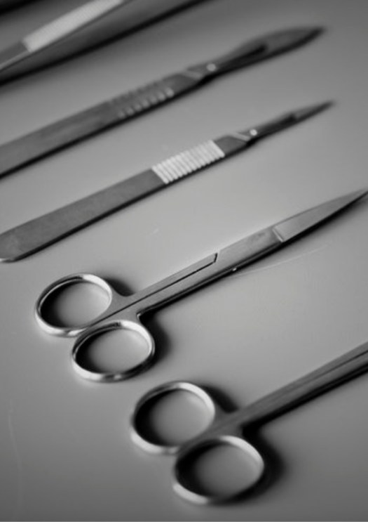 medical scissors and scales on a grey background