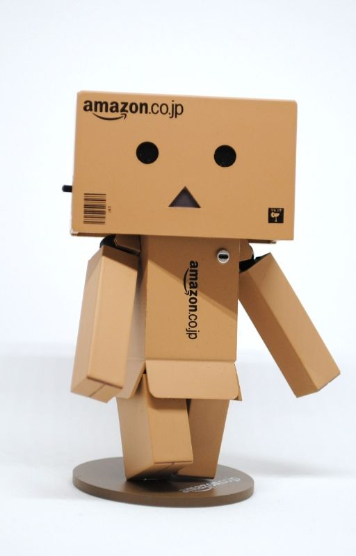 humanoid made using cardboard boxes and AWS written on it