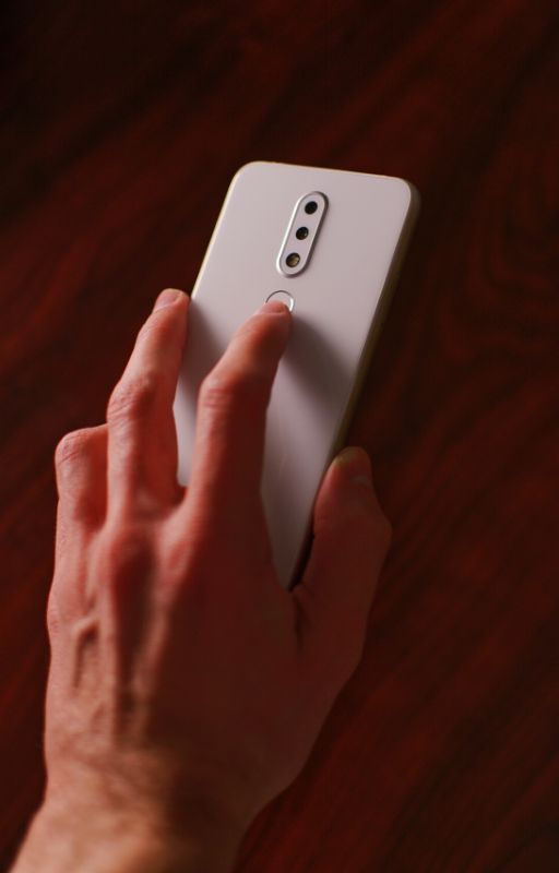 A man unlocking phone with finger touch