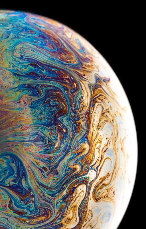 Artistic impression of a planet of vibrant colours to show Terraform process