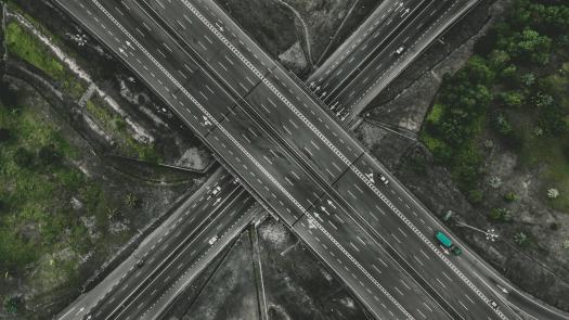 Road and a flyover going in different directions