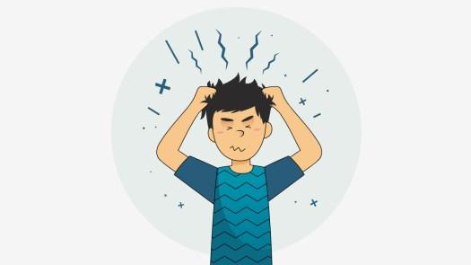A boy holding his hair, having annxiety